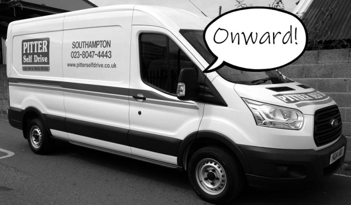 """A picture of a self-drive van with a speech bubble reading """"onward"""""""