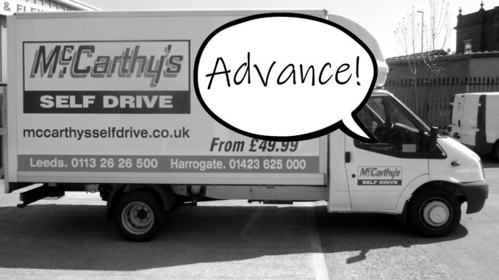 """A picture of a self-drive van with a speech bubble reading """"advance"""""""